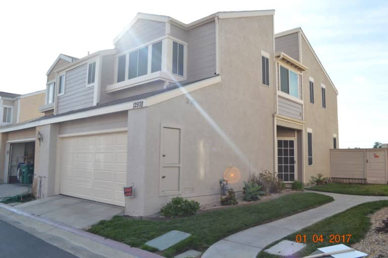 two story house with stucco siding