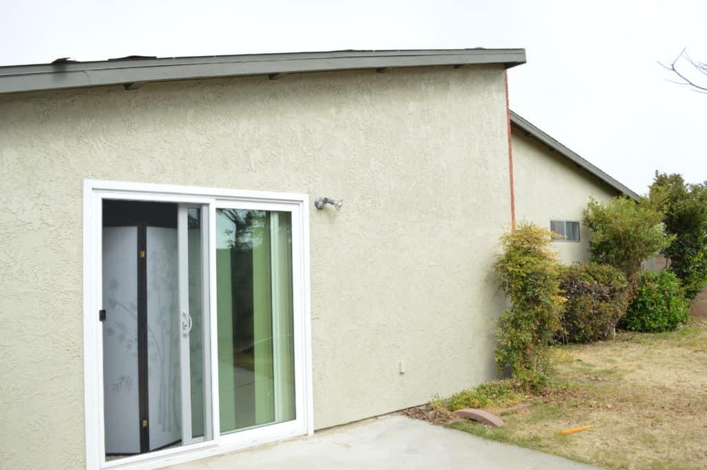 sliding door on side of house