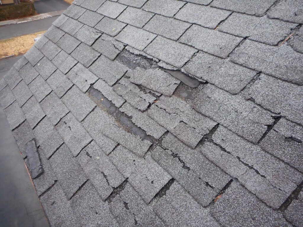 cracked asphalt shingle roof