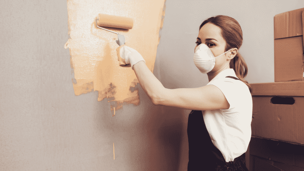women painting with mask and can you use exterior paint inside