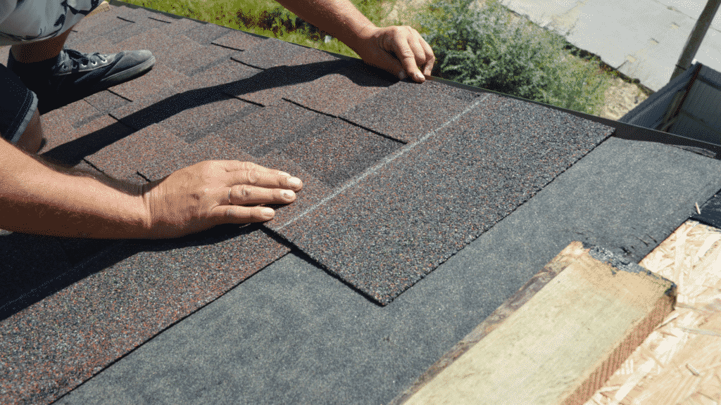 roofing company installing shingles