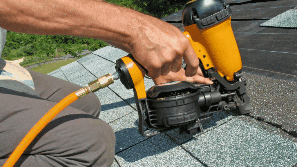 nail gun nailing roof shingles