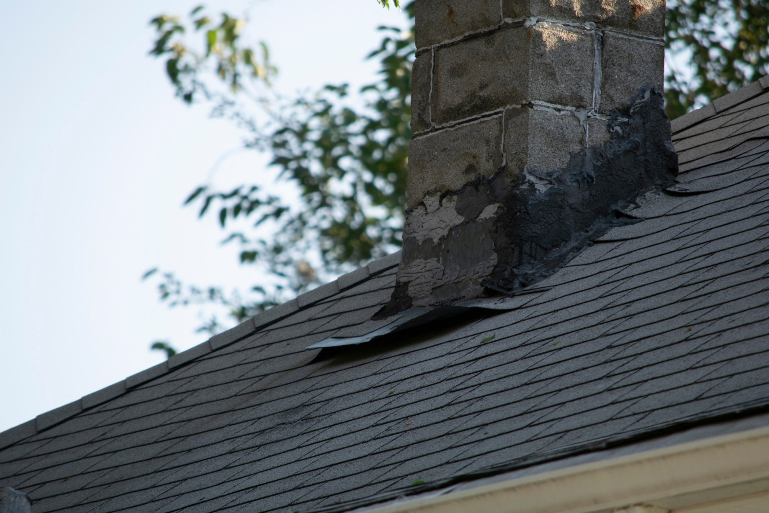Roof flashing lifting and breaking around a chimney